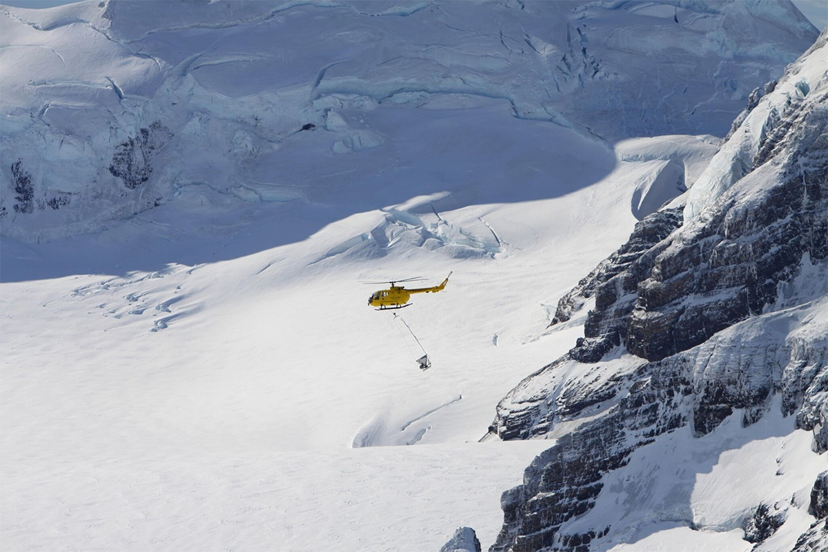 Phase I. Helicopter over icecap close. Credit - Tony Martin