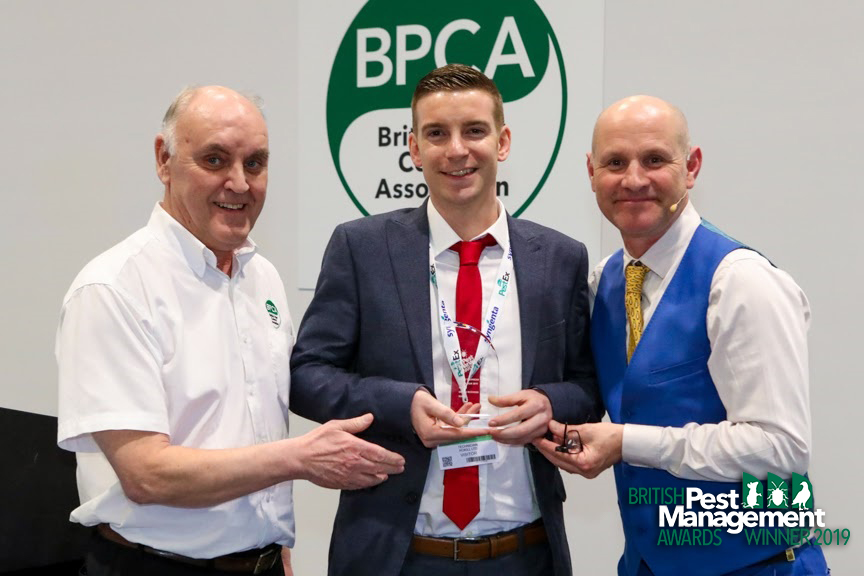 George Rickwood of Rokill (centre) with Kevin Higgins, a member of the BPMA's judging panel (left) and event host, TV wildlife presenter Mike Dilger.