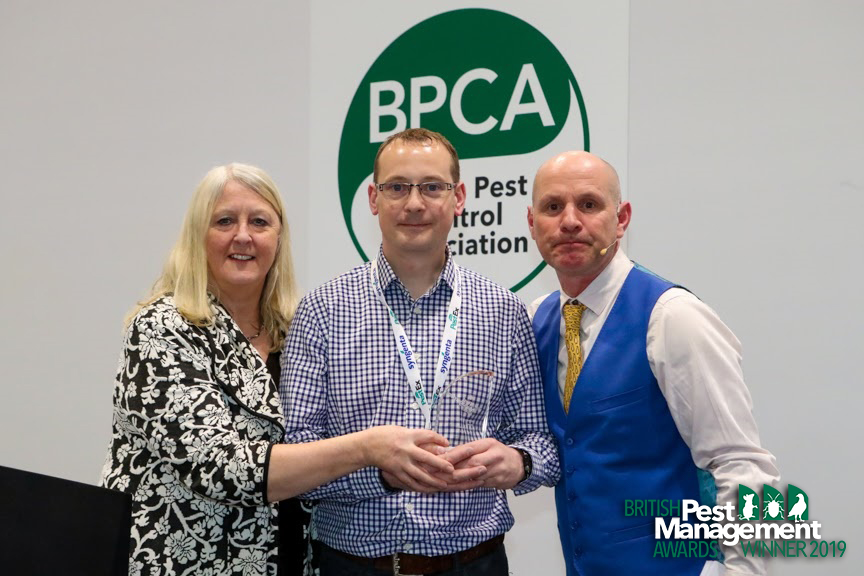 Peter Goodrum of NBC Environment (centre) with Frances McKim, a member of the BPMA's judging panel and event host, TV wildlife presenter Mike Dilger (right).