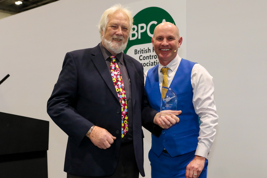 Dr Jonathan Wade (left) being presented his Lifetime achievement award by television ecologist Mike Dilger (right)