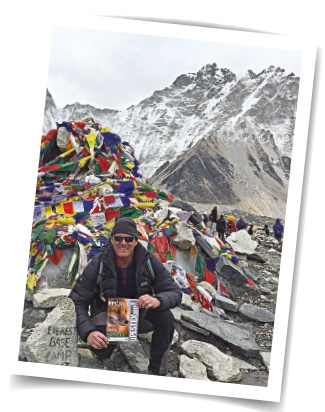 David Lacey at Everest Basecamp with some quality reading matter in case of, y'know, boredom.